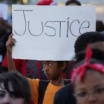 Child at Mike Brown protest. Photo: Freep.com