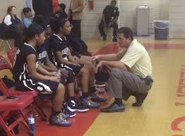 The coach and his players at gametime.  photo: feministcurrent.com